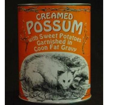 Not just any possum in a can. Oh no. This is CREAMED possum in a delectable COON FAT gravy and delicately garnished with sweet potatoes. Yummy.