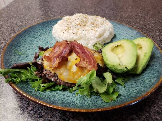 Bacon cheese burger on lettus with mashed cauliflour