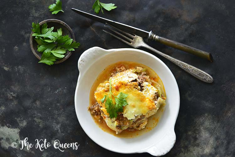 Low Carb Lasagna with Easy Meat Sauce and Cabbage Noodles on Metal Background