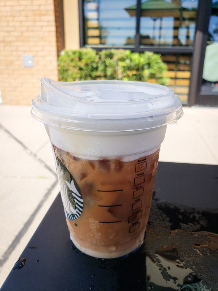 image of a Iced Starbucks Blonde Cold Foam Cappuccino on a table outside of starbucks
