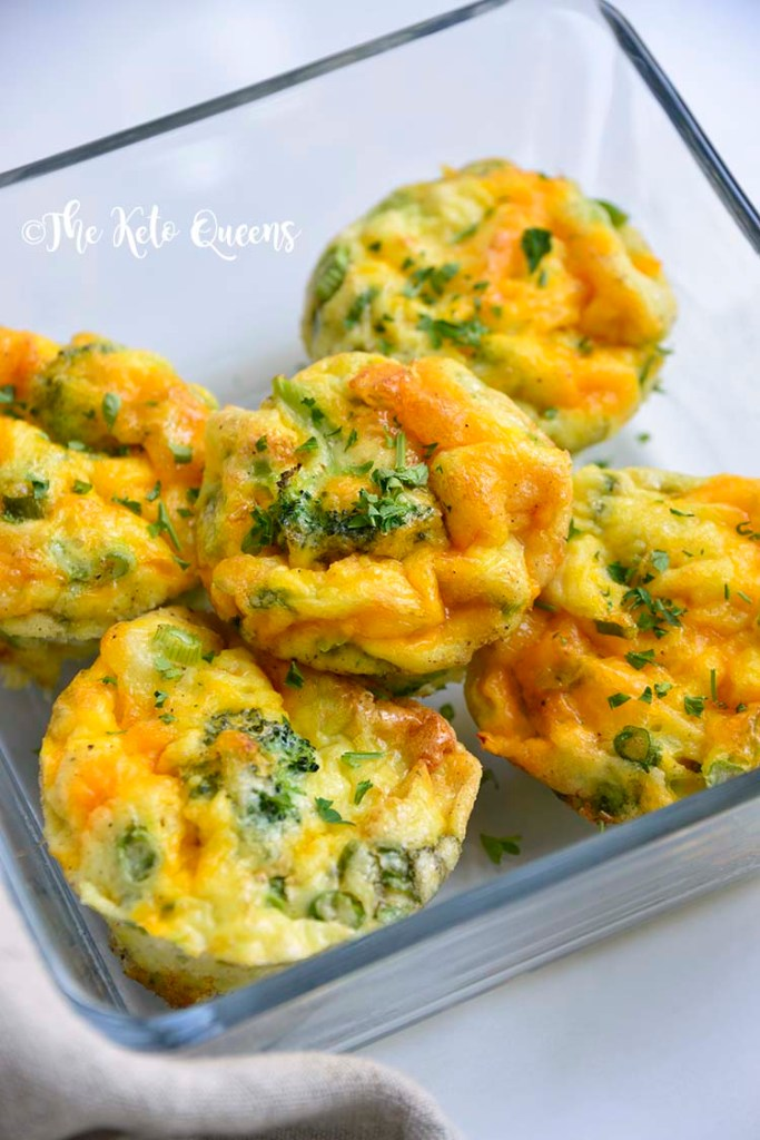 vertical image of broccoli and cheddar egg muffins in a glass storage container