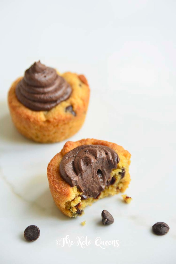 2 Chocolate Chip Cookie Cups with Chocolate Buttercream frosting and 1 with a bite taken out