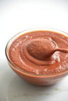 bowl of sugar free BBQ sauce i a clear bowl with a spoon