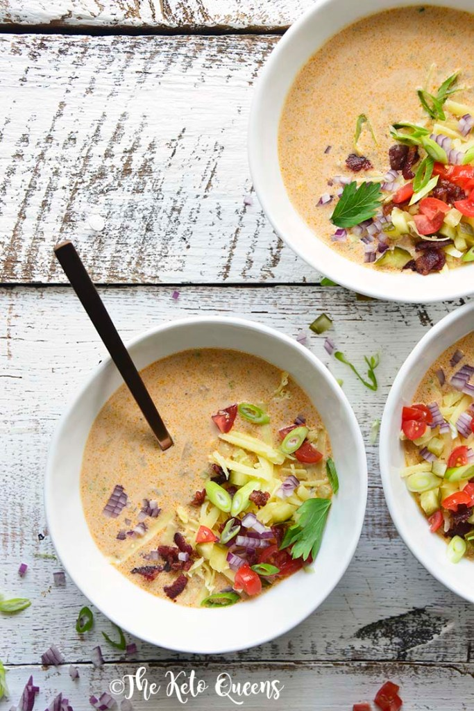3 bowls of Keto Bacon Cheeseburger Soup with garnishes and a spoon