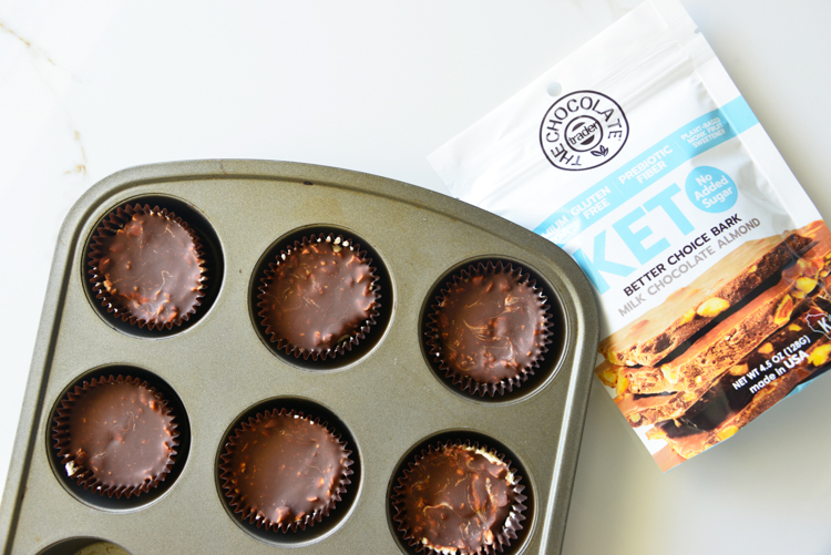chocolate keto cups in a muffin tin with the chocolate traders package