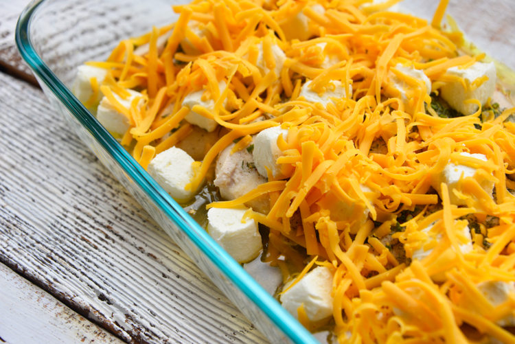 baked crack chicken topped with cream cheese and shredded cheese