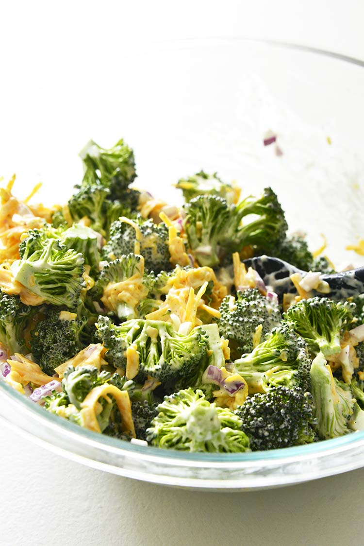 Mixing Broccoli Salad with Dressing