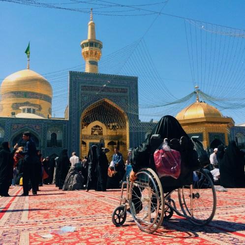 A woman is preying. Taken from inside Imam Reza Shrine, Revolution area