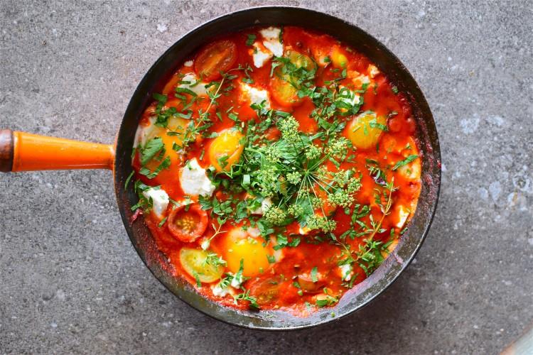 Shakshuka Eggs with Goat Milk Fett and Fresh Herbs