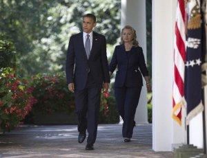 Obama and Hillary walk to rose gardene