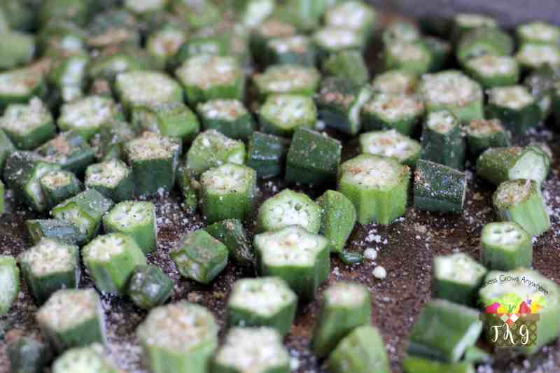 seasoned okra on a cookie sheet