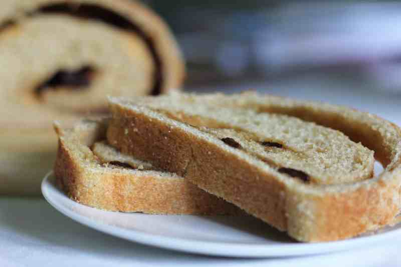 Two slices of Cinnamon Raisin Bread on a white plate