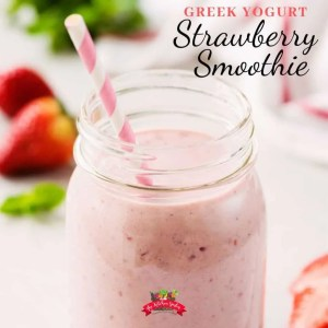 strawberry smoothie in mason jar with striped straw
