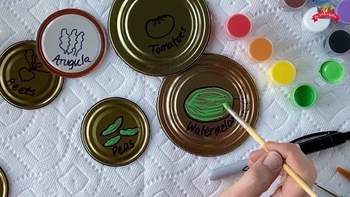 green paint on can lid garden markers
