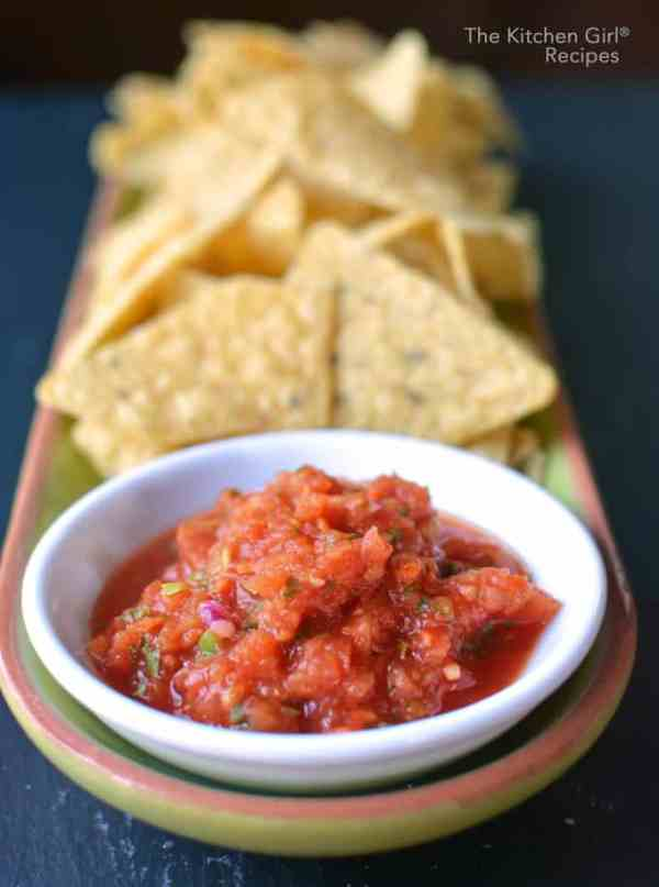 This homemade salsa recipe takes 5 minutes! It's an easy salsa recipe made with canned tomatoes, garlic, onion, cilantro, serrano, and lime #healthymexican #homemadesalsa #paleosalsa #paleo #vegan #cincodemayo #salsa #texmex #restaurantsalsa