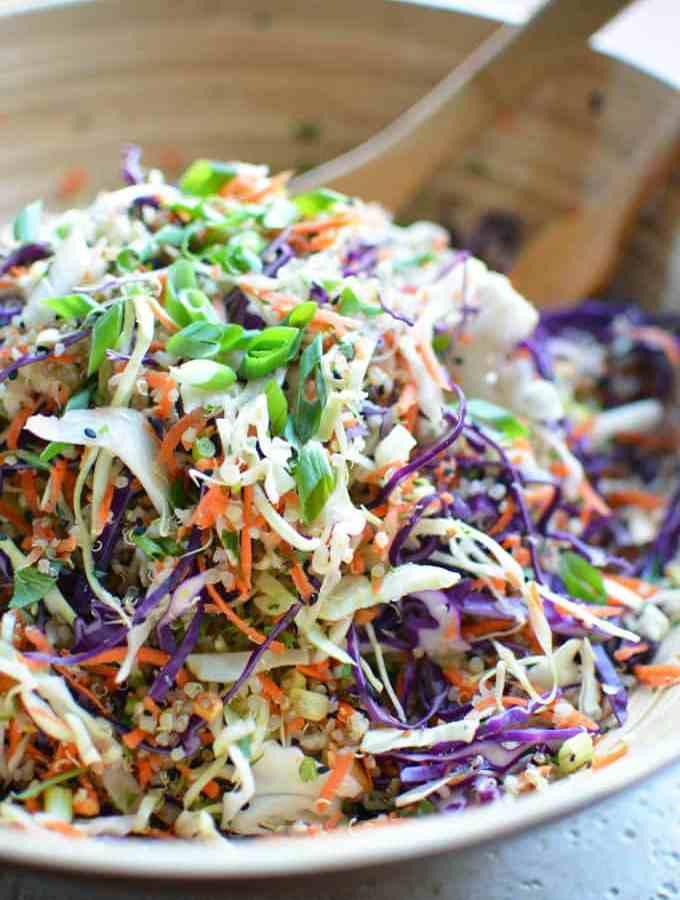 Meal prep, eat clean! Asian slaw salad is made with everyday produce, quinoa, and Asian salad dressing. Asian Slaw Quinoa Salad with Sesame Ginger Vinaigrette. thekitchengirl.com #asiansalad #asianslaw #orientalsalad #mealprep #glutenfree #choppedsalad #vegan