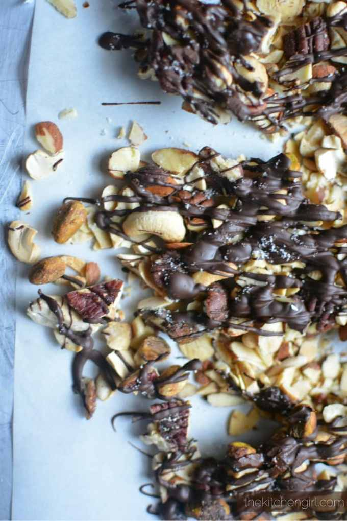 Best Christmas Crack EVER! You won't be able to stop eating this. Sweet and salty heaven! GF Black Truffle Salted Dark Chocolate Drizzled Nuts on thekitchengirl.com