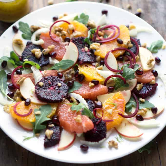 Quench your body with a Citrus Fennel Arugula Salad and eat ALL the nutrients during winter! thekitchengirl.com #citrussalad #wintersalad #orange #grapefruit #bloodorange #pomegranate #arugula #walnuts #beet #beetroot #fruitsalad