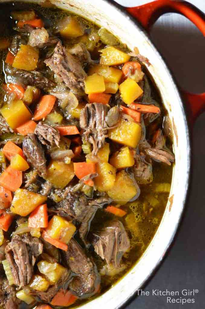 One pot Guinness wonder! Guinness Braised Beef Short Ribs and vegetables. thekitchengirl.com #beefstew #stpats #shortribs #beefvegetablestew #guinnessfood #beerfood #glutenfree #stpatsfood