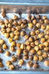 Crispy lowfat fiber protein snack? Yes plz! Healthy Herb Roasted Chickpeas on thekitchengirl.com #vegansnack #bakedchickpeas #roastedchickpeas #healthysnack #bakedgarbanzos