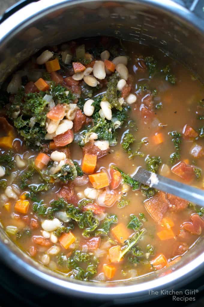 Tastes like it cooked ALL day, but ready in 30! Instant Pot Vegan Tuscan White Bean Kale Soup #instantpot #instantpotsoup #vegansoup #whitebeansoup #tuscansoup #beansandgreens #pressurecookersoup