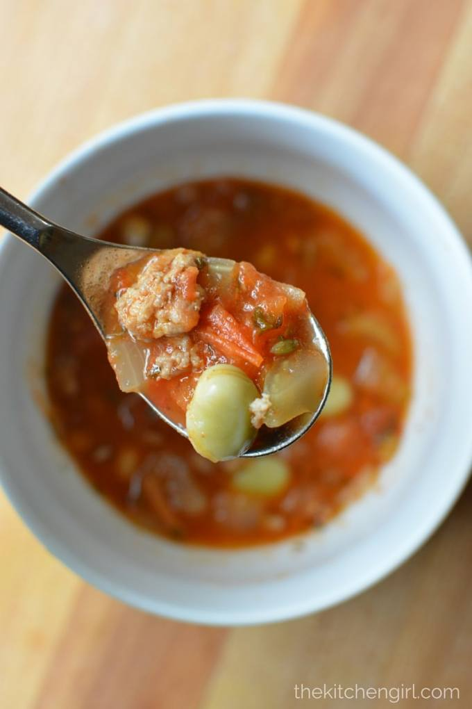 Italian Sausage Tomato Soup is savory, soup heaven in 30 minutes. Sausage, tomatoes, and fava beans rock this GF soup! thekitchengirl.com