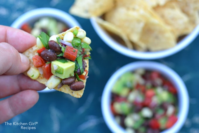 Wow! Secretly healthy party food in 15 minutes = empty bowl! Mexican Black Bean Corn Avocado Salsa is a vegan, gluten free dip! thekitchengirl.com