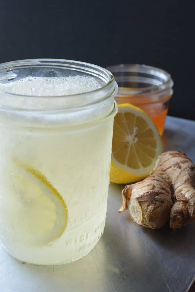 Sore throat pain? You'll LOVE this Miracle Slushie Sore Throat Relief recipe! Easy to make in a blender with ice and a few, natural ingredients. Kids love it! thekitchengirl.com #sorethroatremedy #coldrelief #naturalcoldrelief #ginger #lemon #honey #sorethroatslushie