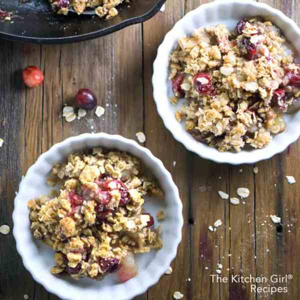Secretly healthy holiday dessert! Scrumptious Pear Apple Cranberry Crisp is skillet baked with a crispy oat topping. #applecrisp #vegan #glutenfree #cranberries #holidaydessert #fruitcrisp #healthydessert