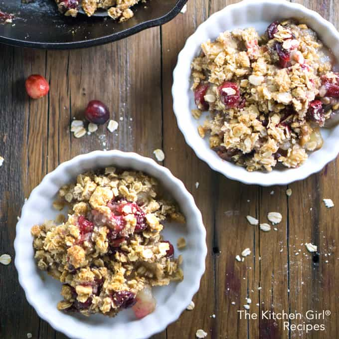 Secretly healthy, scrumptious vegan holiday dessert! Maple Pear Apple Cranberry Crisp at thekitchengirl.com #applecrisp #cranberries #holidaydessert #vegandesserts #fruitcrisp #glutenfreedessert