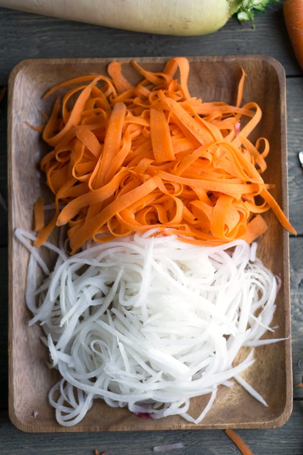 This is the sweet sour veggie topping you get on a Vietnamese banh mi sandwich or salad. Quick Pickled Carrots and Daikon recipe on thekitchengirl.com #vietnamese #carrots #daikon #pickledcarrots #quickpickle #banhmi #vegan #glutenfree