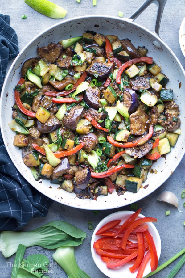 Weeknight vegetable stir fry in a savory, Chinese pan sauce. Stir Fry Vegetables with Black Bean Sauce is naturally vegan and ready in 30 minutes. #asian #stirfry #vegan #vegetarian #mealprep #Chinesefood #weeknightmeal #blackbeansauce