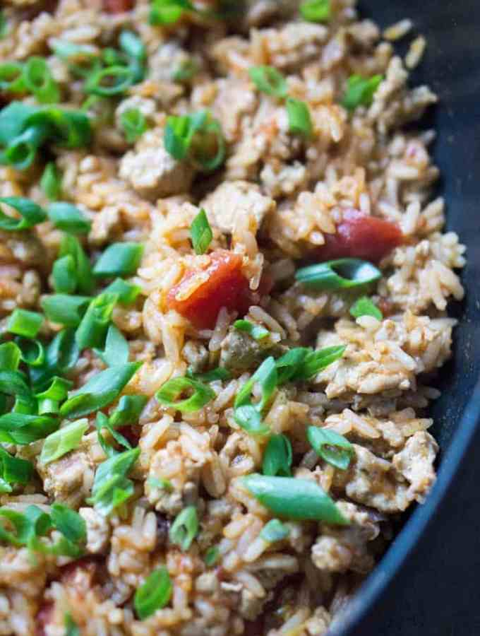 Healthy filling for tacos, burritos, or nachos! Ground Turkey Taco Mexican Rice Skillet on thekitchengirl.com. #healthymexicanfood #skilletrecipe #30minutemeal #mexicanrice
