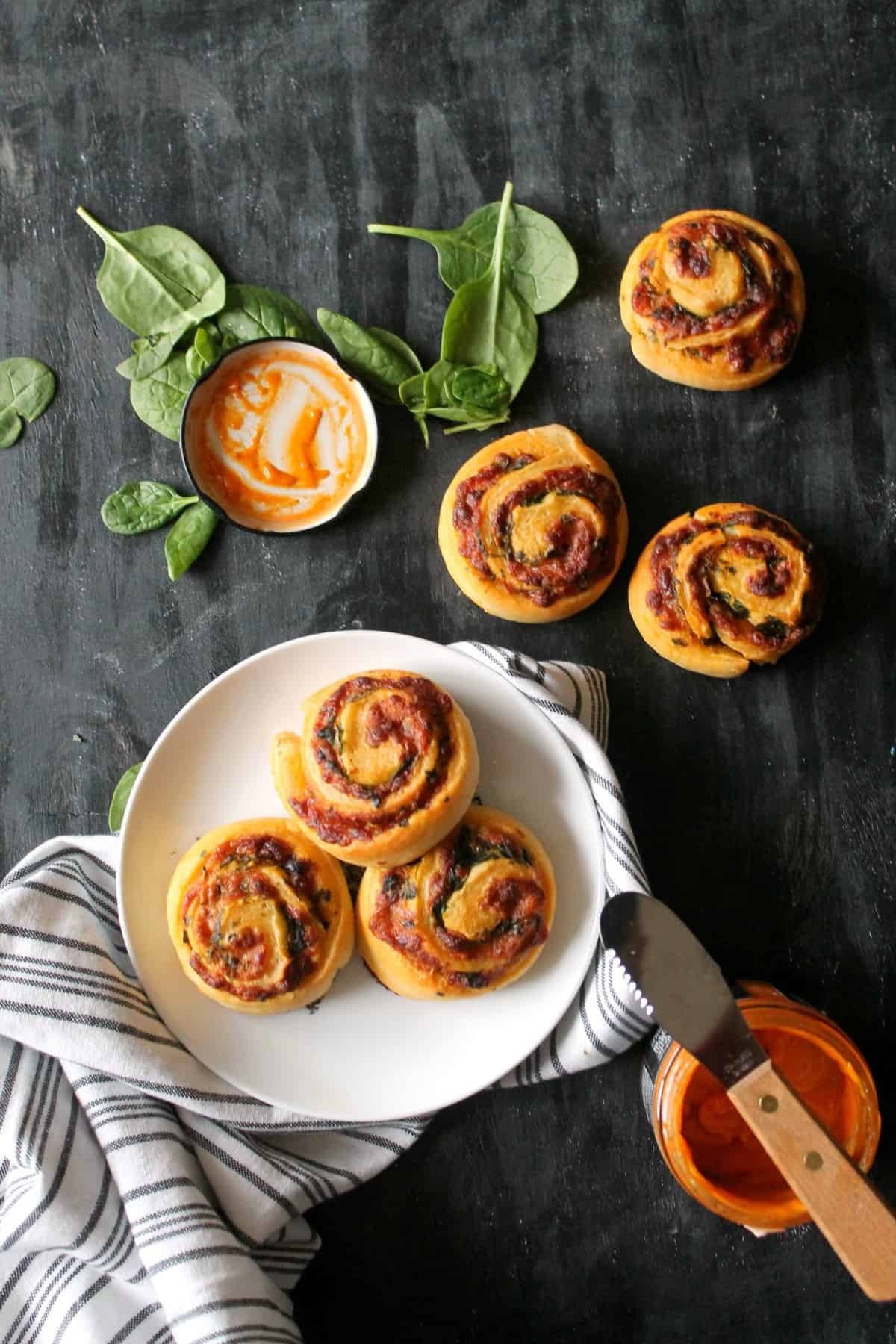 Cheesy Tomato, Basil & Spinach Pinwheels. These 5 ingredient appetizers will be star of your next party! So easy to make and bursting with flavor!