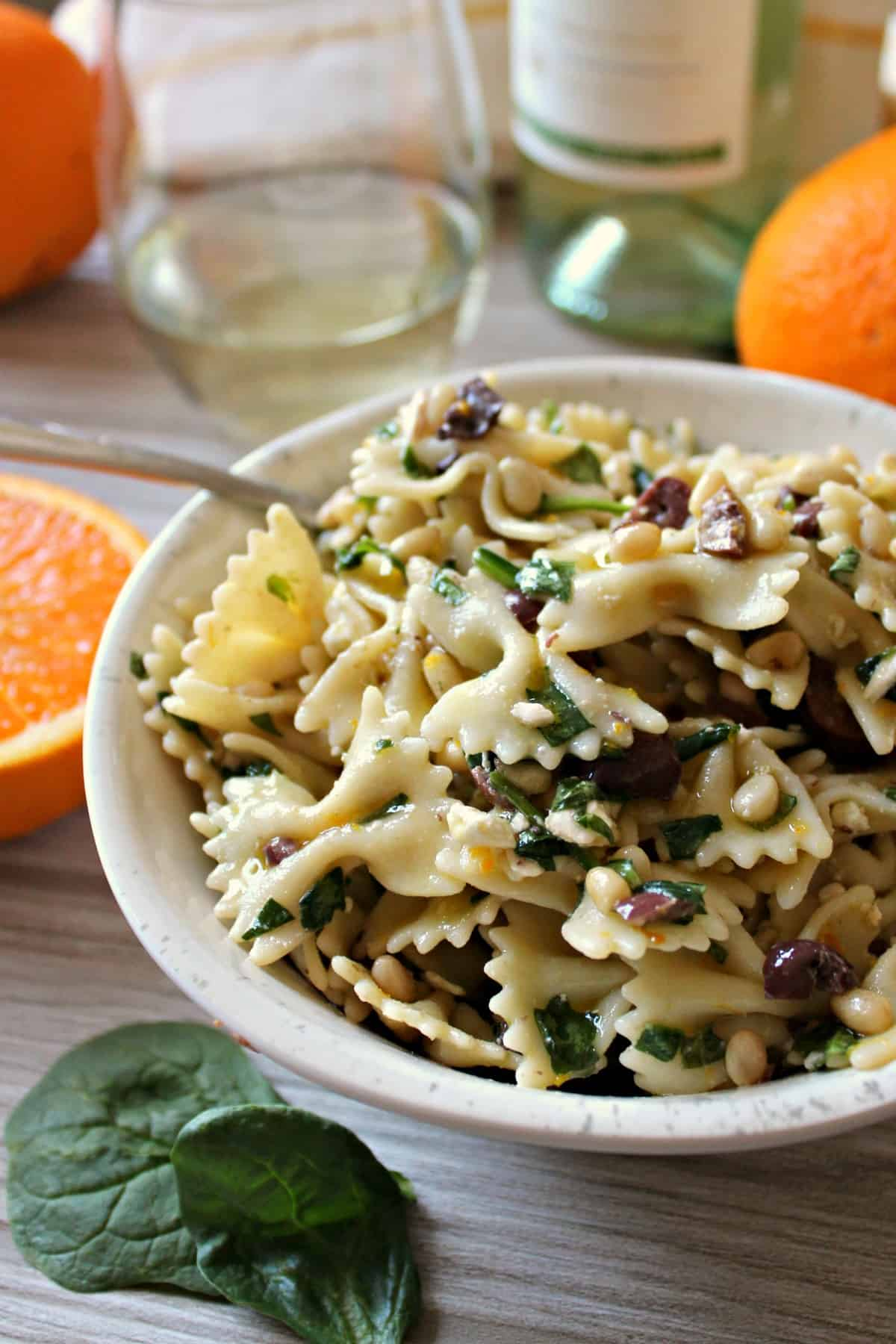 Citrusy Spinach, Olive, Feta & Pine Nut Pasta Salad is an ideal dish for laid back summer entertaining. Not only does it come together quickly, but it's also a great recipe to make ahead so you an focus on the best part of summertime: relaxing! Pair with light, refreshing Cavit Pinot Grigio for effortless elegance.