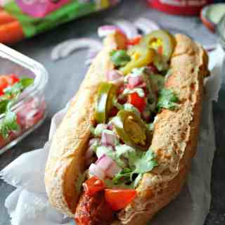 """Tex-Mex """"Carrot Dogs"""" with Cilantro Garlic Yogurt Sauce. A meatless version of a summer favorite: Smoky carrot """"hot dogs"""" loaded with Tex-Mex toppings!"""