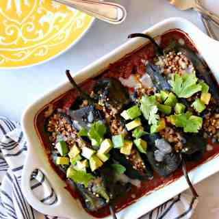 This healthier, summertime version of chiles rellenos (stuffed poblano peppers) turn up the heat AND the nutrition on a well-loved recipe. Poblano peppers are stuffed with a healthful blend of ancient grains {and a little cheese, of course!}, nestled in your favorite store-bought salsa or taco sauce and baked instead of fried, keeping things light yet satisfying for a spiced up dinner on any summer day.