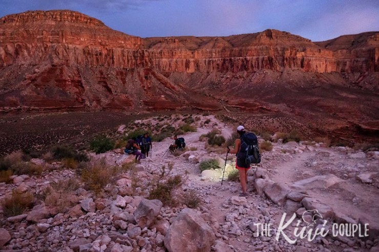 Rachel hiking down into The Grand Canyon at dusk on her way to Havasupai