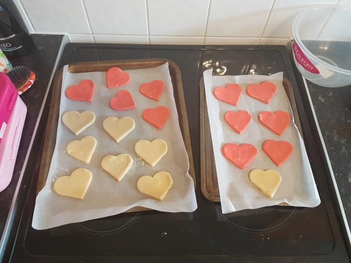 Emily baking valentines cookies