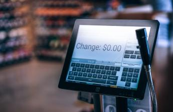 A cash register screen shows a readout of the customer's change.