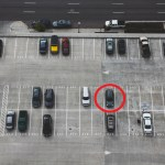 A bird's eye view of a parking lot with the owner's car circled.