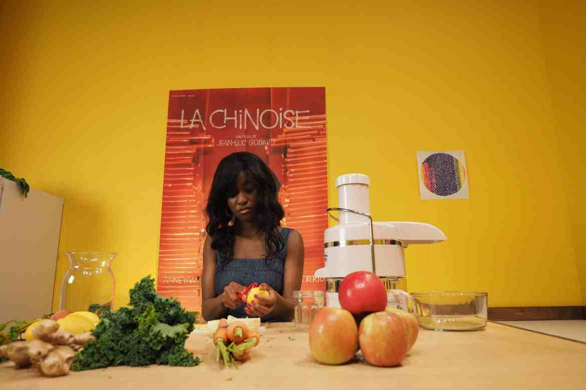 Aurielle Akerele as Janet in the kitchen.
