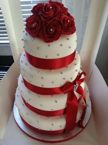 Red Wedding Cakes   THE KNOT  A wedding cake company This cake is called The Red Queen  It has beautiful pearl accents scattered  all over the cake  With the diamond bow in the middle and the red rose  bouquet