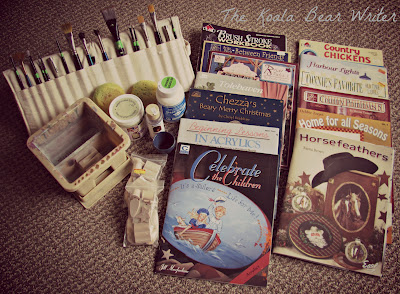 My folk art painting supplies, including brushes and books
