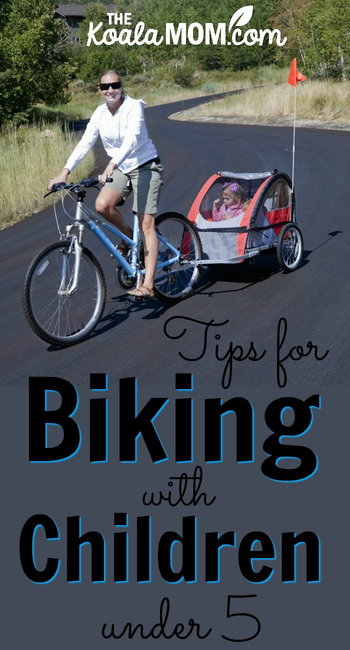 Tips for Biking with Children under 5 (mom on a bike with a child in a bike trailer behind her)