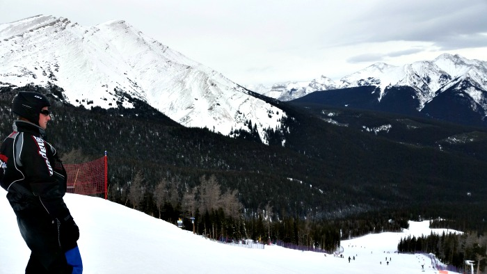 My brother looking down the ski run at Nakiska