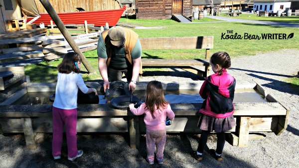 Girls panning for gold at Fort Langley National Historic Site, BC