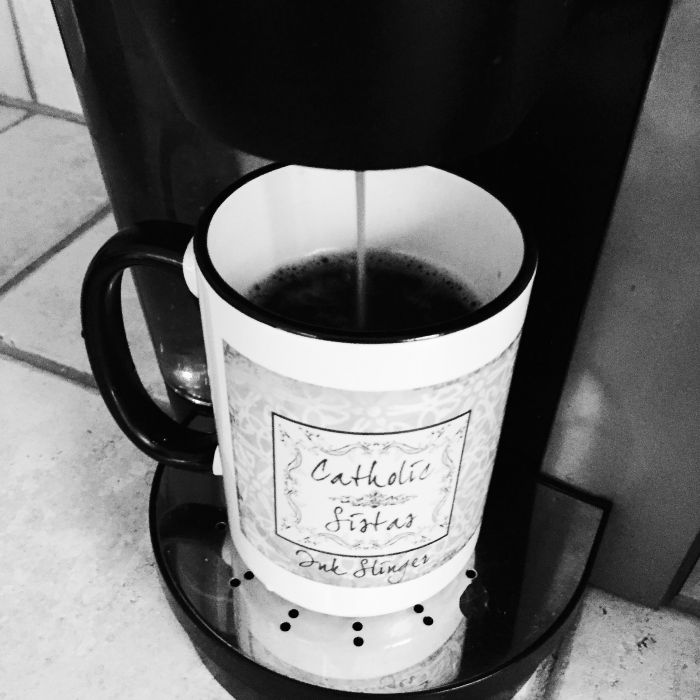 Catholic Sistas coffee mug being filled with fresh coffee - the perfect start to a day in the life of a mom blogger