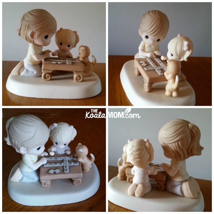 """Precious Moments Mother's Day figurine with a mom playing Scrabble with her daughter while a kitten looks on. Scrabble words spell """"Family loves forever"""""""