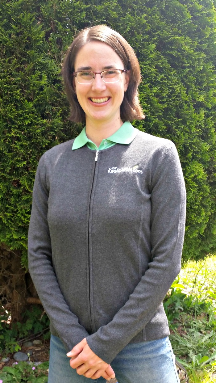 A grey cardigan - suitable for a school uniform - with the Koala Mom logo on the chest